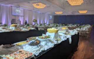 Banquet hall setup with food and tables